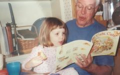 My grandfather reads me a picture book.