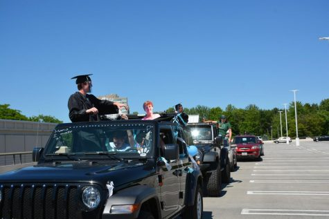 Graduating seniors participate in Whitman's car parade at Westfield Montgomery mall
