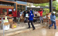 Glen Echo Heights Citizens Association volunteers prepare food orders for delivery.
