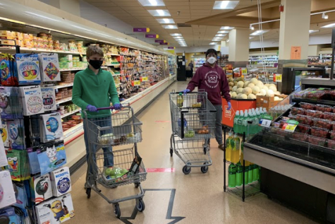 Teens Helping Seniors founders Matthew Casertano and Dhruv Pai shop for groceries before delivering them to senior citizens.
