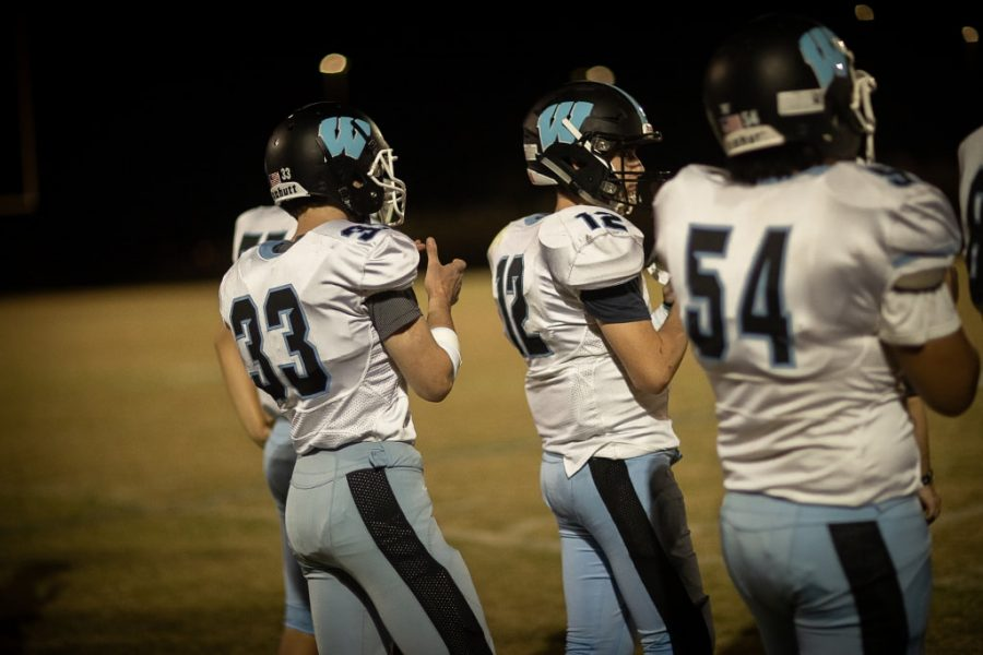 (From left to right) Harry Sikes ('20), Senior Ben Treacy and Chris Yeo ('20) prepare to take the field during a football game last fall. This years' football season is scheduled to start on February 13.