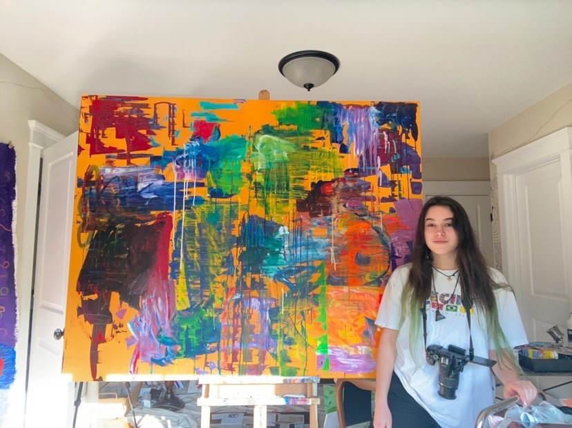 Senior Olivia Tyler and a painting she created over the pandemeic.