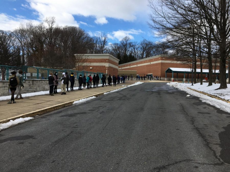 At one point, the line of students, starting from the small gym, reached all the way down the front side of the fence bordering the football field.