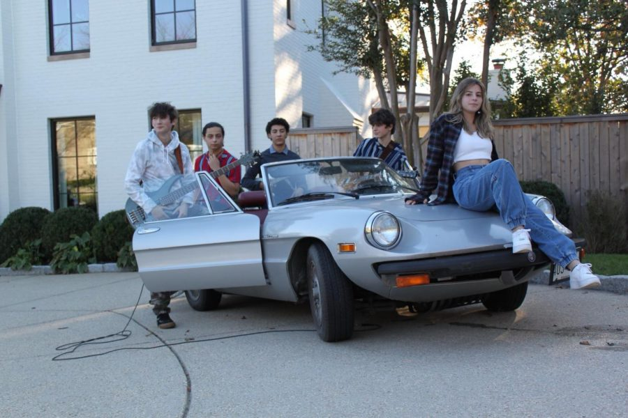 The members of Dark Trilobite, (L to R) Evan Solnik, Sammy Rabinowitz, Alfonso Lopez, Max Mendelsohn and Isabella Cymrot, pose on Mendelsohn's car