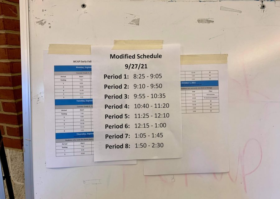 Staff+members+plastered+copies+of+todays+adjusted+bell+schedule+to+various+surfaces+during+first+period.