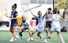 Cadet Carleigh Armstrong (47), who graduated from The Academy of the Holy Cross (20), celebrates during a Westpoint Lacrosse game.