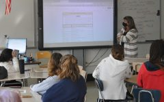 Womens Studies teacher Linda Leslie introduces a research project to her class. Womens Studies is one of the five classes offered as part of the Leadership Academy for Social Justice.