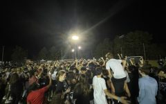 Students dance to the music at Whitmans first outdoor homecoming celebration. The event drew the most students in at least five years, according to Principal Robert Dodd.